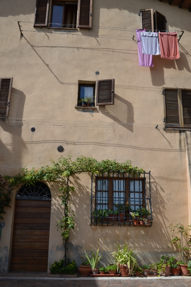 laundry day quaint homes in tuscany, montepulciano, italy