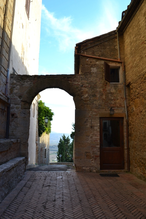 archway in tuscany, montepulciano, italy