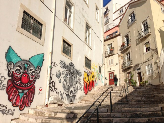 street art on the way to castelo de são jorge in lisbon, portugal - alfama