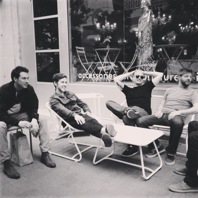 Boys relaxing while girls shop in Austin, Texas